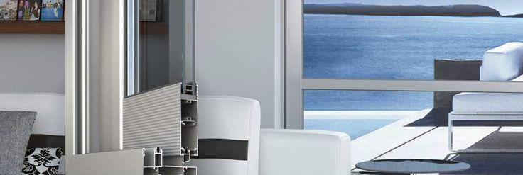 Alumil M14000 #porte e #finestre scorrevoli non isolate termicamente. • Larghezza anta: 38 mm • Guide di acciaio inossidabile • Ampia gamma di tipologie realizzabili • Possibilità di persiane e zanzariere scorrevoli