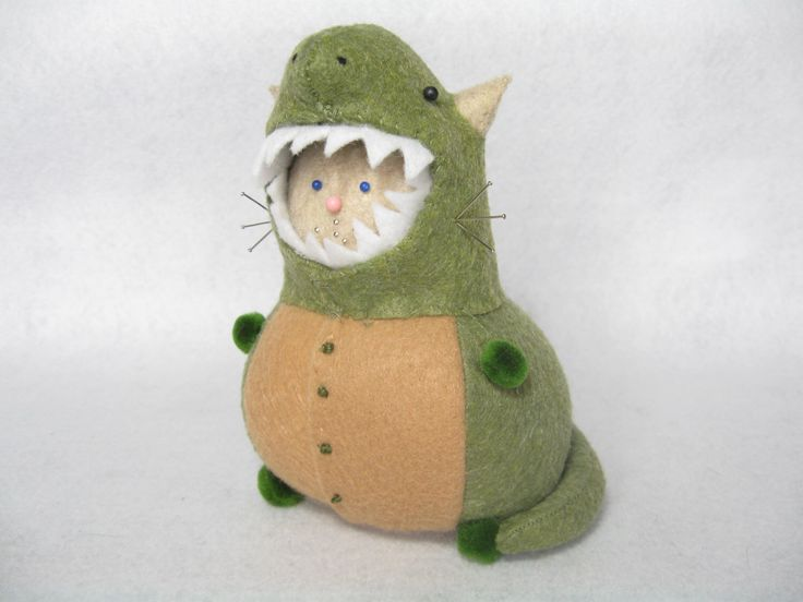 T-rex cat, Cute felt pincushion, Dino cat, Funny cat gift, For dinosaur lovers, Stuffed dino, Cat in costume, T-rex decor, Cat art doll by TheFatCatFactory on Etsy https://www.etsy.com/listing/469393740/t-rex-cat-cute-felt-pincushion-dino-cat