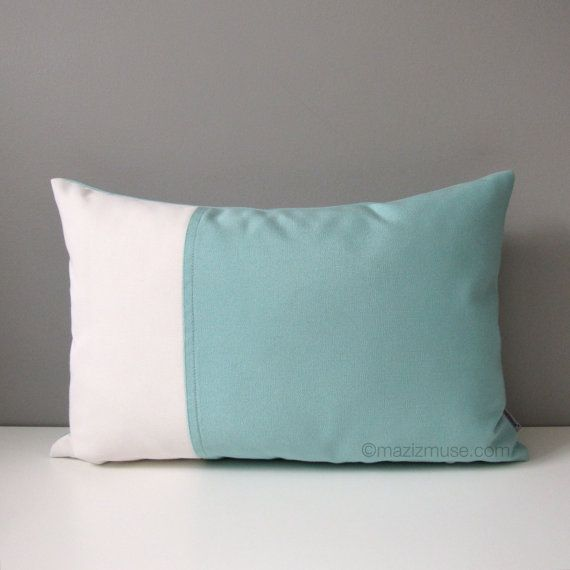 A cooling shade and modern pillow cover in Aqua Blue and White color block. Sewn in Sunbrella indoor outdoor fabric for superior colorfast & stain