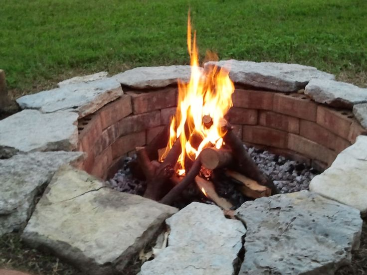 My homemade fire pit. Cost: $0.00....simple and made from repurposed brick and creek rocks with some gravel in  bottom?