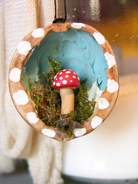 a tiny toadstool in a walnut decoation! by kathaurielle, via Flickr. includes mini tutorial!