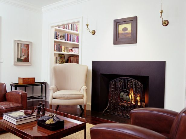 The Richly Toned Heavy Furniture In This Living Room Anchors Look With Only A Few Simple Wall Accents Needed To Finish
