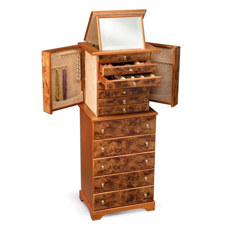 This piece is actually two separate chests. The upper one is specifically designed for jewelry, while the lower one could be used for jewelry, lingerie, or a variety of other small items. The upper chest has six real drawers and one faux drawer at the top where the mirror panel fits when lowered. Two of the drawers each have one large and fifteen small compartments; two each have three equal compartments; one has a large middle compartment and four front-to-back ring slots, and one is not…