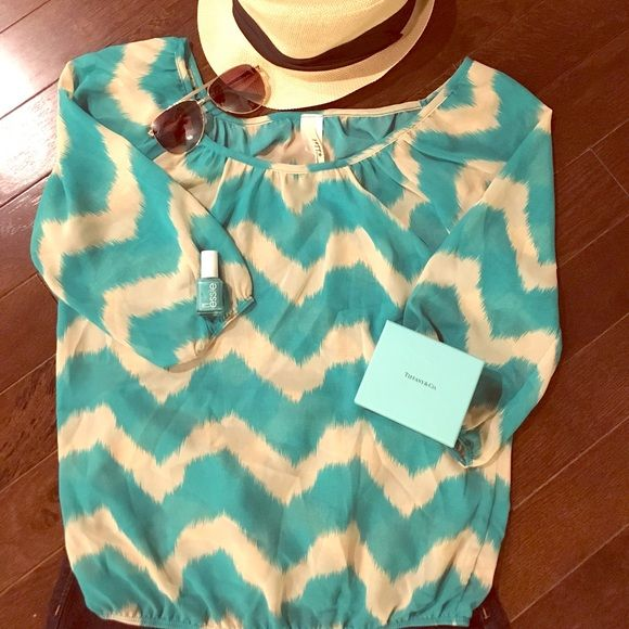 Chevron top with 3/4 sleeve Teal and cream chevron top with 3/4 sleeve. This top is perfect for spring! Tops