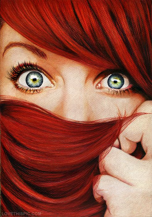 Red hair with captivating eyes.