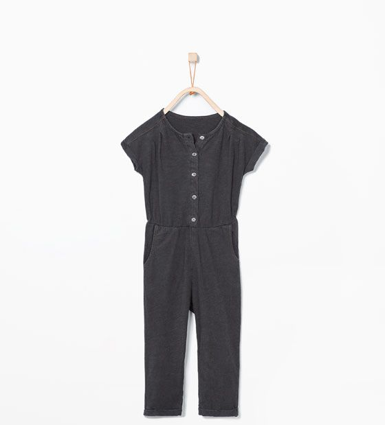 Buttoned jumpsuit with shiny details