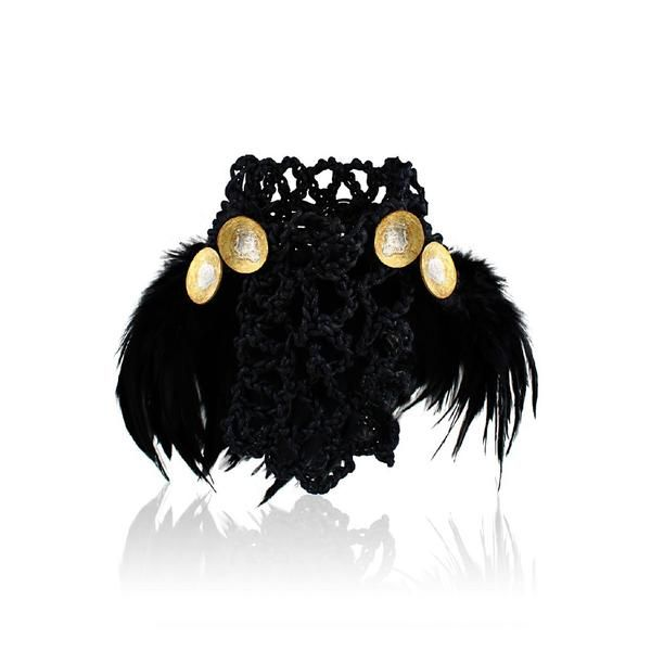From #amsterdam, this choker with show-stopping accent commands attention! The choker is made of crochet cotton cord, each handcut  brass button has a sterling silver layer in the center. the black feathers are sewed on one by one by hand. #HappyHalloween #Curated @ TheArtOfLiving.Earth
