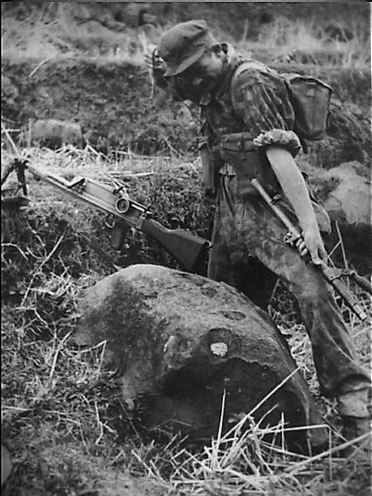 Dutch soldier of KNIL with a Bren LMG.