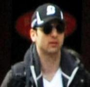 Tamerlan Tsarnaev was wearing explosives and an explosive trigger when his body was recovered.