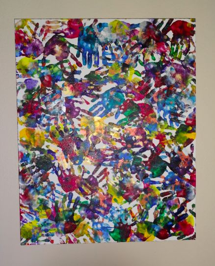 "Hand-print mural - great idea for a collaborative class canvas ("",)"