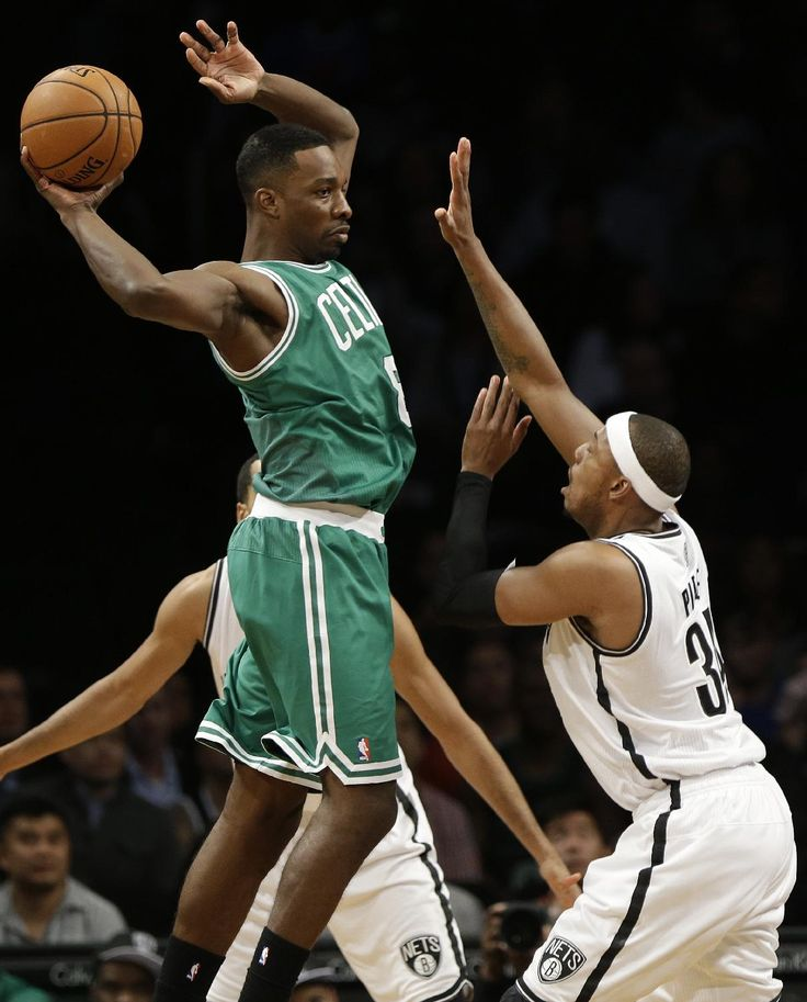#NBApreseason Boston Celtics' Jeff Green (8) passes away from Brooklyn Nets' Paul Pierce (34) during the first half of a preseason NBA basketball game Tuesday, Oct. 15, 2013, in New York. (AP Photo/Frank Franklin II)
