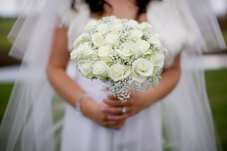 Bridal bouquet of akito roses and gypsophilia
