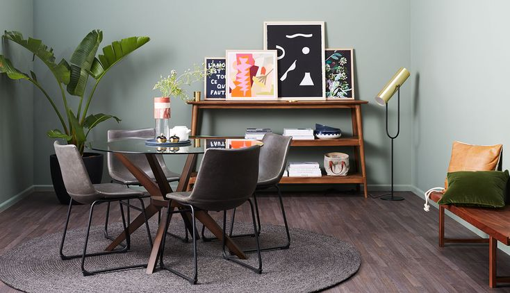 Noir Dining - This dining room demonstrates how to do eclectic without overdoing it, with cool tonal greys and blacks alongside pops of colour and warm timbers it is all about finding a balance. For renters that can't hang art don't be afraid you layer up and lean multiple prints, buy things you love and they are guaranteed to work together.