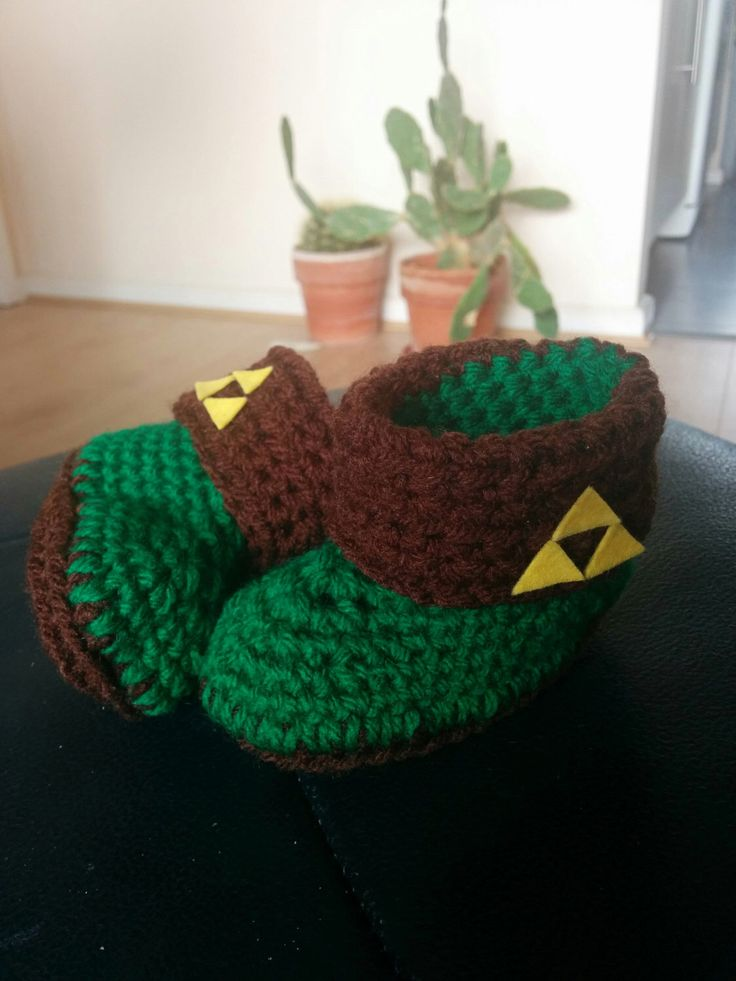 Crocheted baby booties - Legend of Zelda triforce by MariskaMadeIt on Etsy https://www.etsy.com/listing/247561933/crocheted-baby-booties-legend-of-zelda