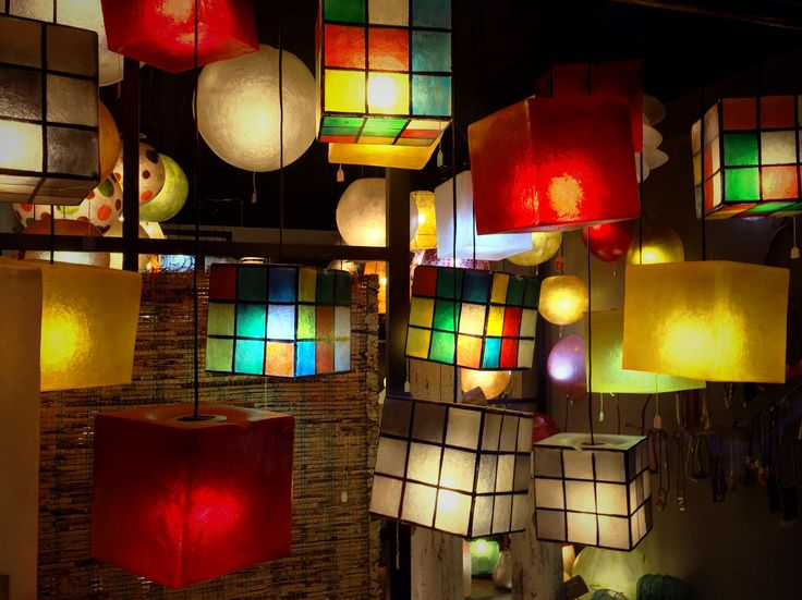 Lighting fixture in the shape of a cube, made out of fiberglass. It can be hung from the ceiling as the central lighting fixture of any space, or be put on any surface (table, shelf, floor) as a lamp standing on it own.  Dimensions: 20 x 20 cm  Fiberglass material is very lightweight, as well as very robust (it doesn't break easily!) so the cubes can be easily moved around.  Available in five colours: yellow gold, wine red and natural white, color Rubik's and B&W Rubik's.