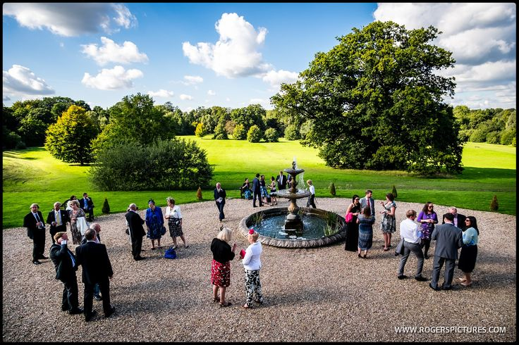 Wedding guests enjoy a fine late Summer's day at Botleys Mansion -