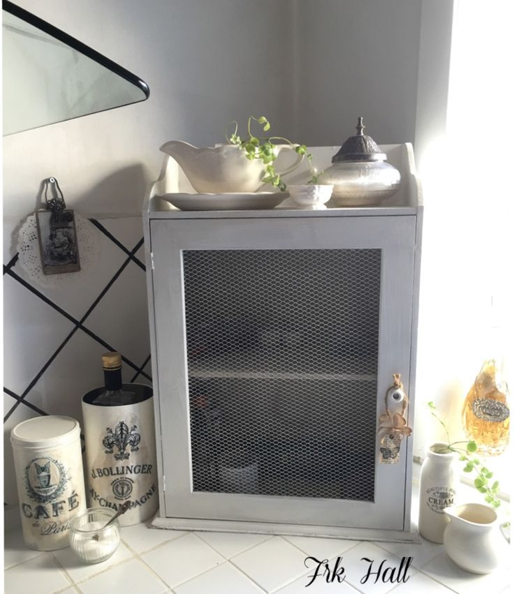 An old white painted shabby chic closet in my romantic kitchen