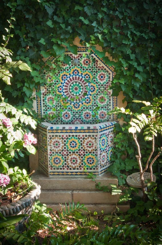 I think gardens should be full of surprises, like this small tile fountain tucked into a secluded corner. ~s