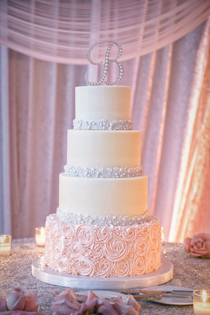 Elegant 4 tier wedding cake with pearl and rose motif (Jeff Kolodny Photography)