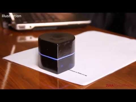 Holy cow, we NEED one of these mini robot printers. It's like a Roomba mated with your office printer.