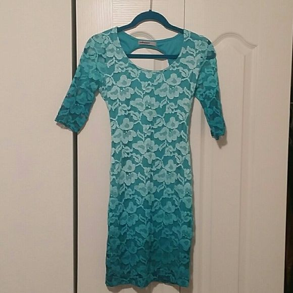 Cut out back Lace Dress! Turquoise lace dress! Back is cut out. Very cute and sexy. Great for a party dress. Showshopper! Never worn. Brought for vacation in Miami but was too small. :( Dresses