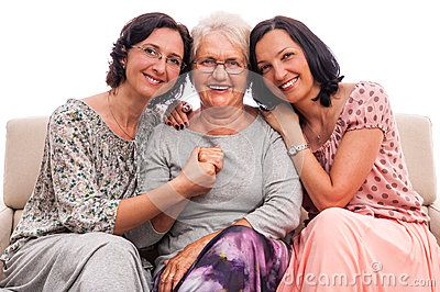 Senior mother embraced adult daughters. Happy family of three. Isolated white background. Peace love care.
