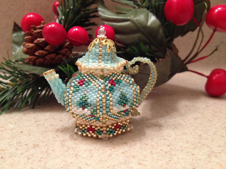 "Winter scene beaded teapot. Sewn bead by bead. Takes about 8 hrs to make. It's only 2"" tall. Takes about 1500 seed beads."
