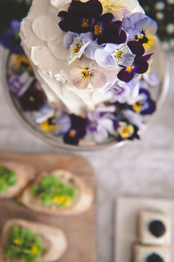 Sweet and simple cake topped with edible violets! | Photo by Bit of Ivory | Styling by Healthfully Ever After #violets #edibleflowers #cake