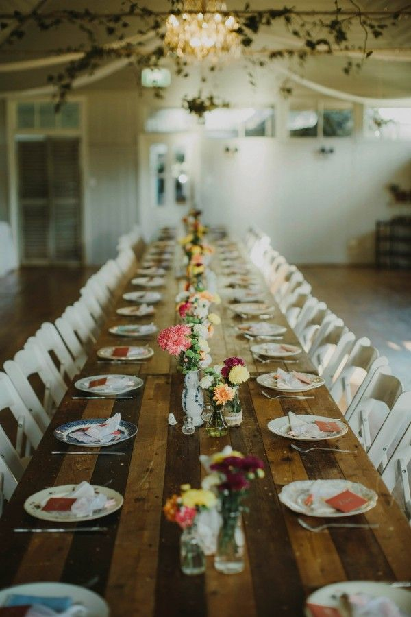 Farm table, mismatched vintage plates, and pretty floral centerpieces | Photo by I Got You Babe