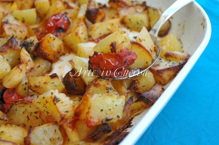 Patate al forno con origano e pomodorini, ricetta contorno, ricetta facile con patate, patate al forno, patate al pomodoro, patate all'origano, carne,pesce