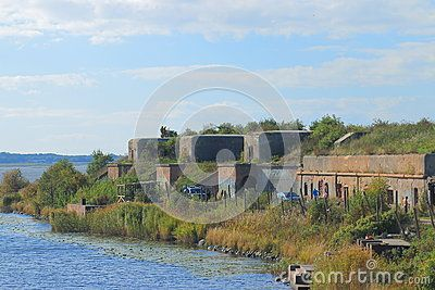 Old concrete strengthening of the 1 North Fort near Kronshtadt on a sunny day. Saint-Petersburg, Russia