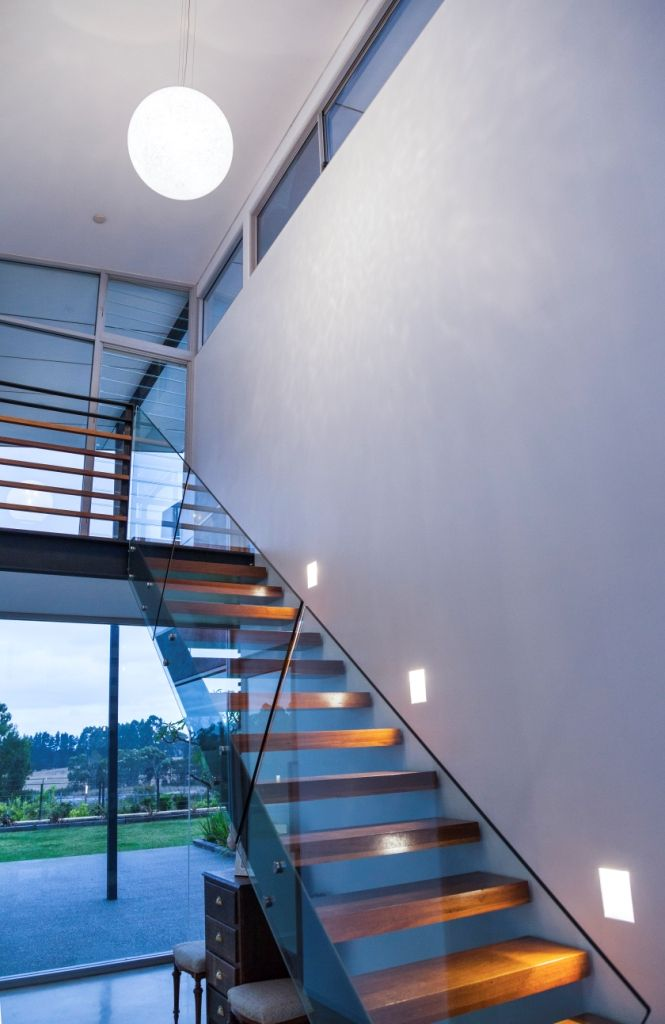 FOYER -  open stair treads in recycled jarrah.  Vistosi Rina Pendant with white glass murrhines.  Wever and Ducre recessed rimless recessed wall lights illuminating stair treads and frameless glass balustrade.