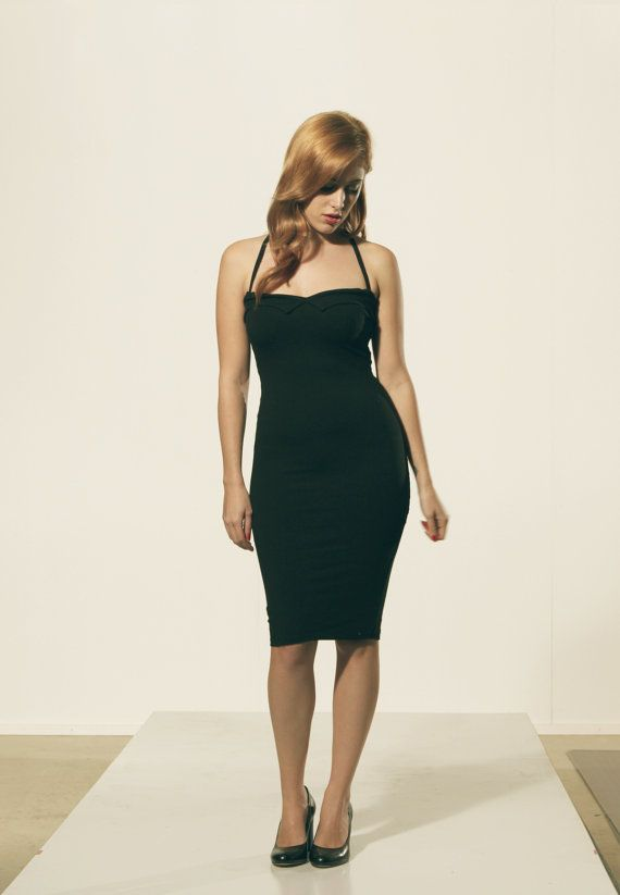 Black sexy cocktail party dress. Figure hugging with shape wear material. Wiggle dress with rockabilly design. Love heart chest with black thin