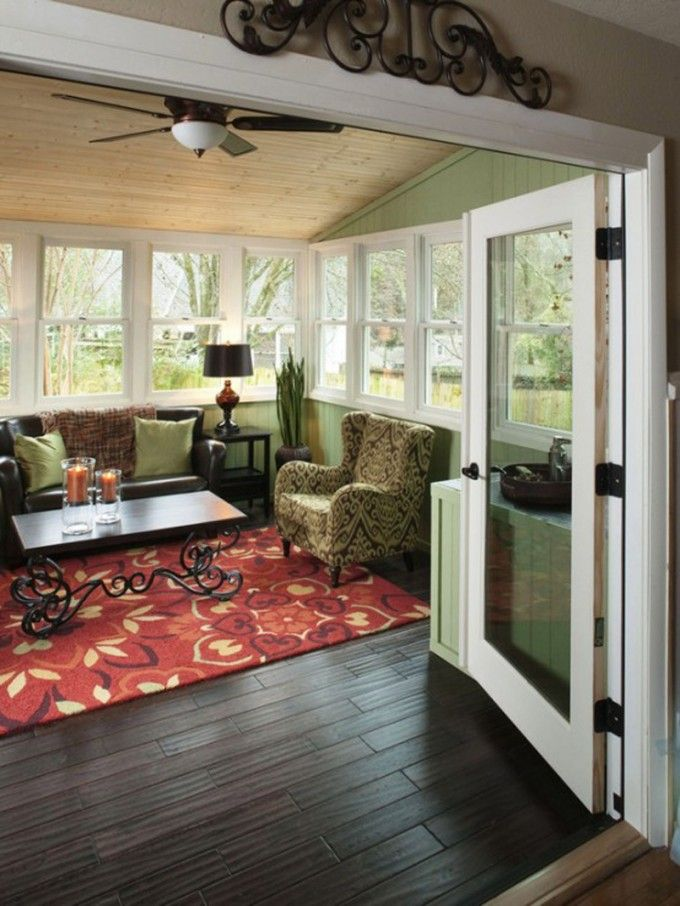 Warmth And Cozy Sunroom Design Examples To Inspire You : Sunroom Design Idea With Autumn Fall Color Scheme And Wooden Floor Along With Black Leather Sofa And Recliner Chair Also Red Rug