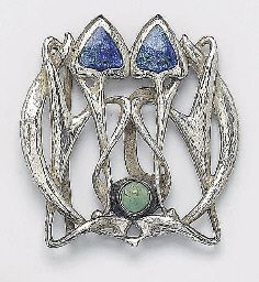 Arts and Crafts cymric belt buckle in silver, enamel and turquoise (1900) - Archibald Knox for Liberty.  (Birmingham, England.)  -kc
