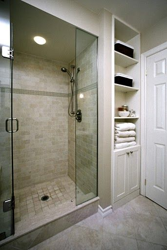 Love the shower, but the built in storage is beautiful! From Avalon Interiors.