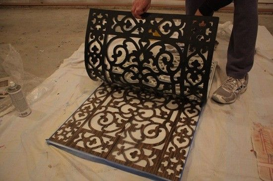 OMG - I love this project! I did doors on a cabinet - beyond awesome! On this photo from lemontreecreation...: she stained wooden boards with a dark stain - placed doormat on top - then sprayed over all with 4 light coats of creamy colored paint - letting dry between coats. Make sure you get the paint into all the openings. Do not move mat until it is completely dry or it will smear. When you remove it the stained wood that was covered by the mat leaves a beautiful design. You can use any…