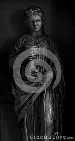 Shot in black and white, detail on an sculpture  representing a female figure placed on the facade of this historic church in Montserrat, set in Barcelona, Catalunya, Catalonia, España, Spain, Europe, Europa