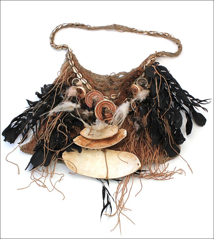 Bilum bag, Papua New Guinea | Richly decorated with feathers, different type of shells and glass beads and has probably belonged to an important figure such as a great hunter, warrior or a sorcerer.