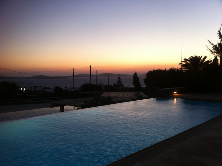 A Mykonos Grand Villa view with a pool in the setting