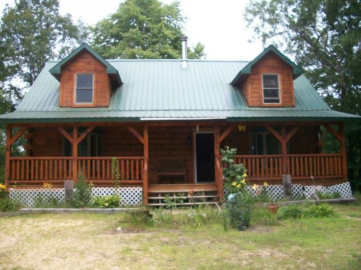Newer Amish Built Log Home With Metal Roof Located On 15 Plus Wooded Acres.  Goodens