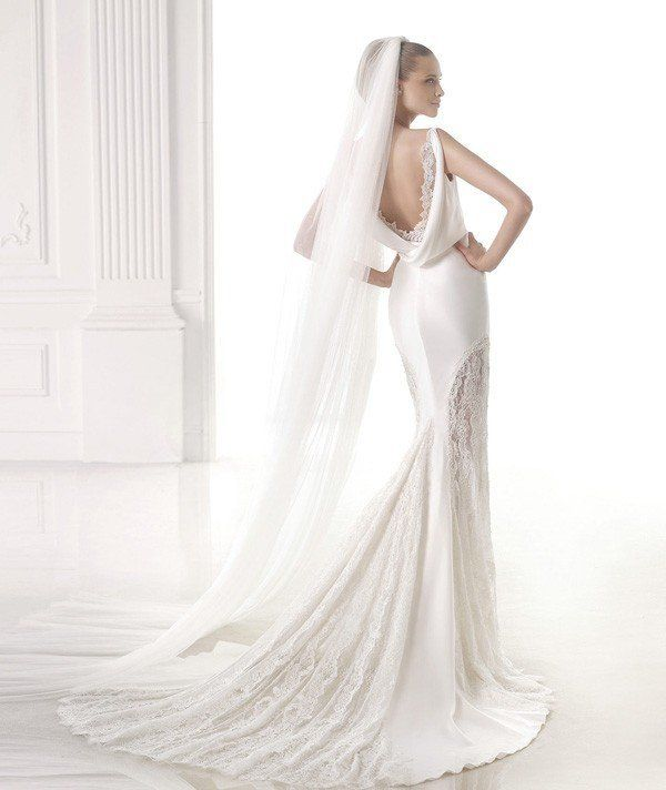 Pronovias wedding dress with low back and sheer panels @myweddingdotcom