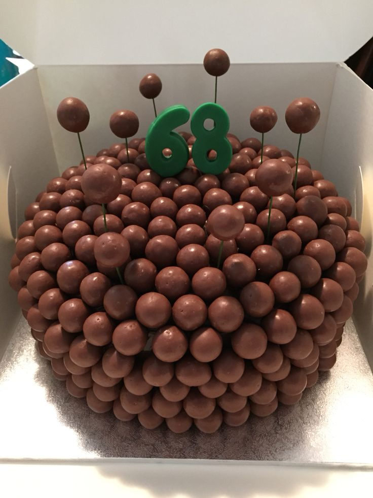 Dad's birthday cake! Moist chocolate mud cake with a hint of Kaluha and layered with dark chocolate ganache. The Malteser effect was a hit too :) Delicious!!