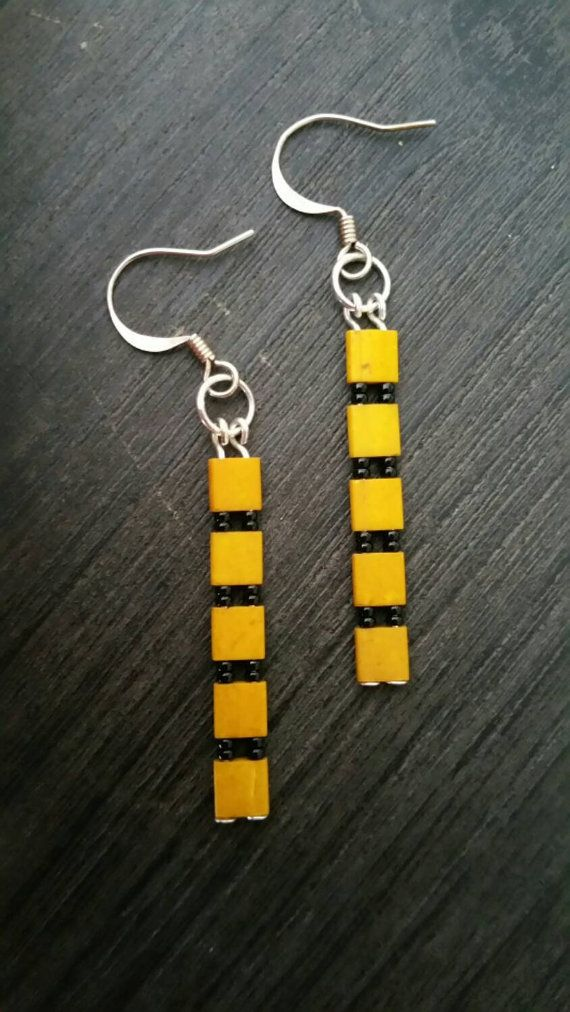 Check out this item in my Etsy shop https://www.etsy.com/listing/262464882/tila-bead-earrings-mustard-tila-beads