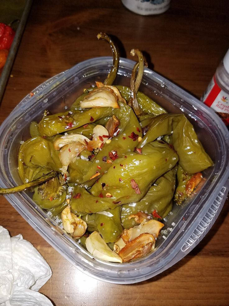 Roasted peppers. Italian long hots (1 pound), Garlic (6-7 cloves), Olive Oil (1 cup), Red chili flakes (dash), Kosher Salt (dash). Roast peppers in 350 degree oven with garlic and olive oil. Let cool, toss with salt and chili flakes.