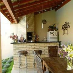 Casa D'água: Terraços translation missing: br.style.terraços.tropical por Thais Costa Arquitetura & Design