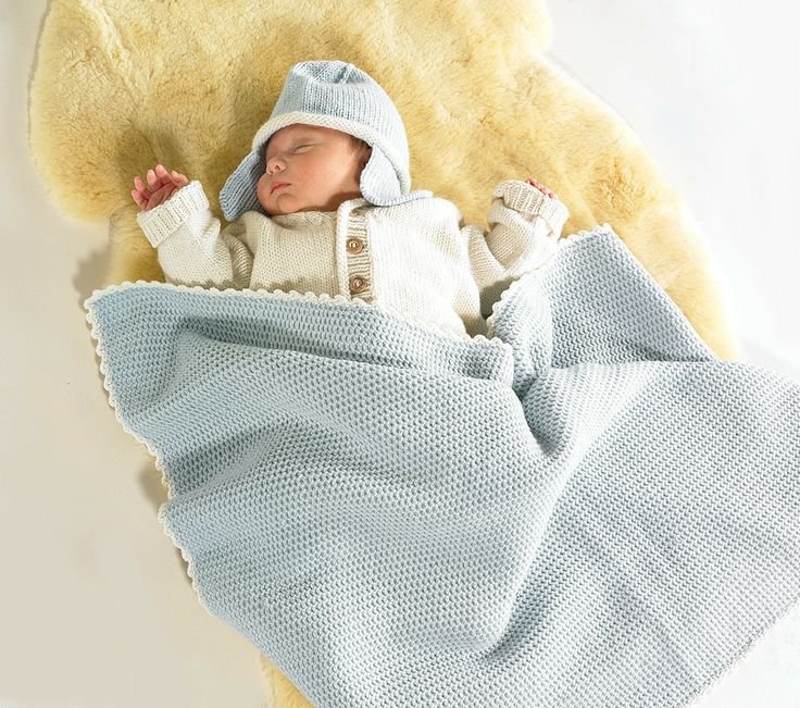 Wrapped in and cosy in our Pale Blue #MerinoHat and #MerinoBlanket | Flordemano