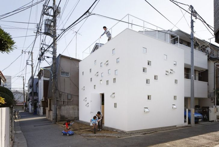 "The resulting ""Room Room"" house is a perforated cube full of small windows, skylights and opening between floors that provide both light and access points"
