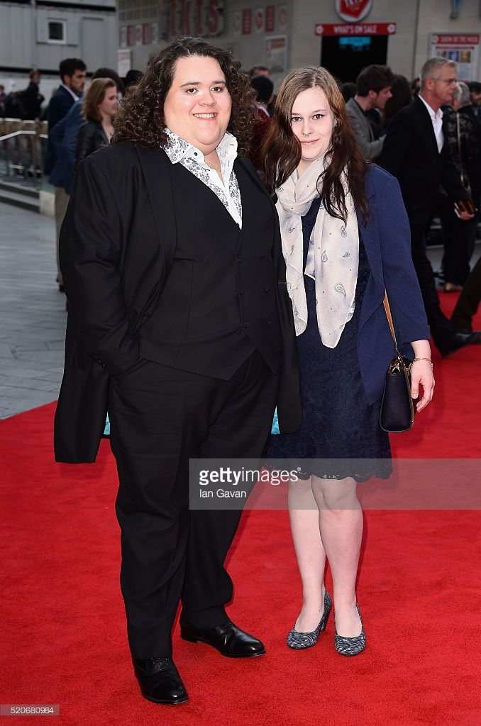 Jonathan Antoine and Michelle Doucet arrive for the UK film premiere of 'Florence Foster Jenkins' at Odeon Leicester Square on April 12, 2016 in London, England.