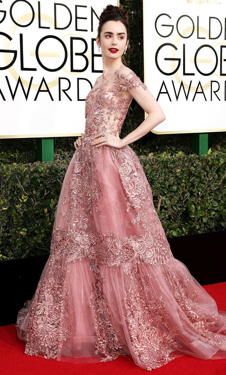Golden Globes 2017: Editors Pick the Best Dressed  Lily Collins in Zuhair Murad: I'm not normally an ultra-feminine, frilly dress kind of girl, so the fact that this dress is pink, lace and a full says a lot — it's just such a princess red-carpet moment. The shade of pink is perfect with her skin tone and red lip — and I love that the dress has an elegant, vintage vibe. It just looks so old-school Hollywood glamorous, which feels very of the moment.